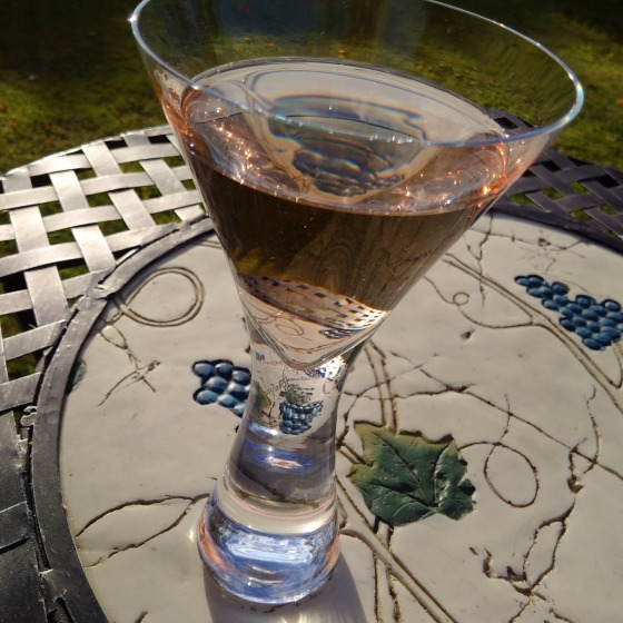 glass of Blush in the garden